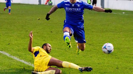Danny Crow, blue, in action for Lowestoft Town on Saturday. Picture: SG PHOTOGRAPHY