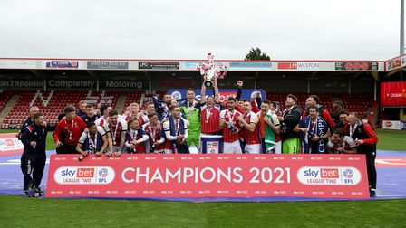 Cheltenham Town players celebrate becoming League Two champions, after the Sky Bet League Two match
