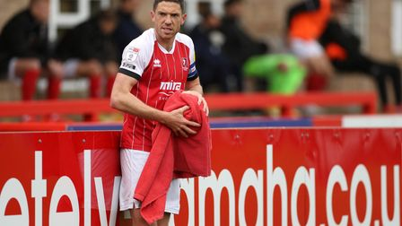 Cheltenham Town's Ben Tozer dries the ball with a towel before taking a throw in during the Sky Bet