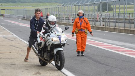 Disability pioneer Claire Lomas heading out from the pit lane on her specially adapted motorbike at
