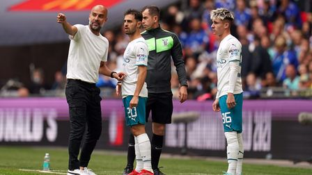 Manchester City manager Pep Guardiola with Bernardo Silva and Ben Knight (right) during the FA Commu