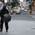 Riot police in Barking town centre after it was cleared of rioters in August 2011.