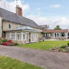 Large brick-washed Norfolk farmhouse with long tarmac drive, conservatory and lawned garden