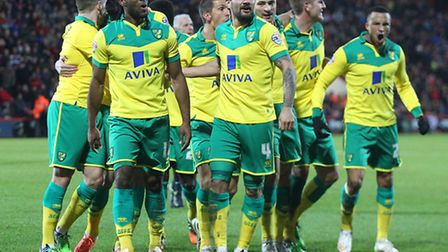Cameron Jerome and co celebrate the new Alex Neil era after scoring the winner at Bournemouth. Pictu