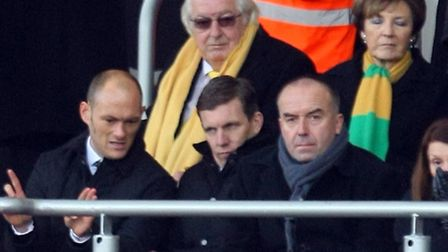 Alex Neil in the stands for his first game, at Bournemouth - before later heading for the touchline.