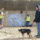 Art by Banksy on North Beach in Lowestoft being covered up after being defaced with white paint