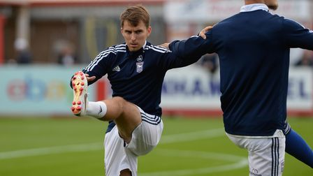 New signing Tom Carroll warming up at Cheltenham Town.