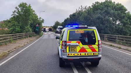 Police are at the scene of the overturned lorry on the A143 near Bury St Edmunds
