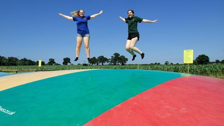 Summer weather in North Norfolk. Leah Catten (left), 20, of Corpusty and Lucy Webb (right), 17 of Ay