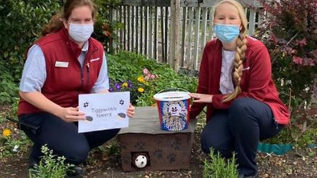 Rebecca Nichols, Ely rail station customer service team member, and Jade Wilkinson, train dispatcher, with hedgehog house.