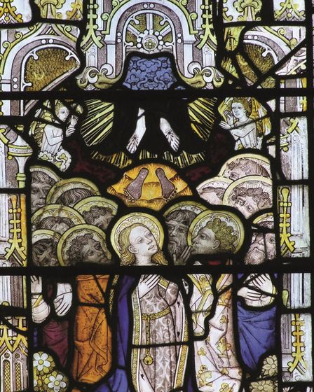 East Harling church has stained glass made in Norwich showing the Ascension