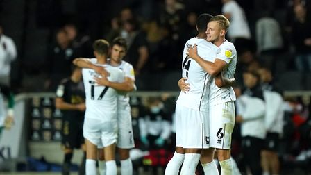 Milton Keynes Dons' Zak Jules and Harry Darling (right) celebrate victory after the final whistle du