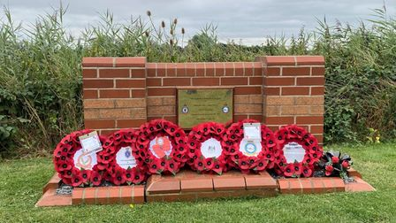 After the service, guests stayed to pay their respects at the memorial, and read the messages on the wreaths.