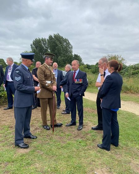 Once the service came to a close, guests stayed to pay their respects at the memorial, and read the messages on the wreaths.