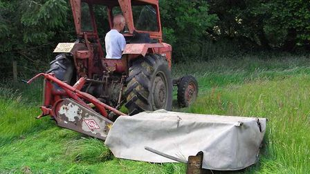 The-Kuhn-disc-mower-in-action-21750d3c