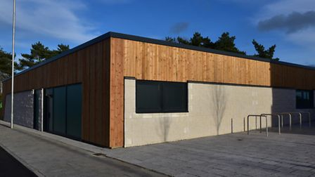 The new building near Asda on the corner of Sandy Lane and Hall Road.