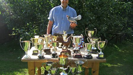 Robin and his favourite pullet with trophies