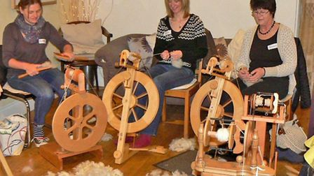 Turning cleaned fleece into wool on a hand spinning machine