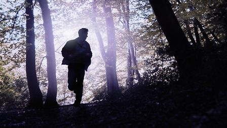 Silhouette of man running in forest. 3