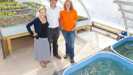 Biologists Charlie Price and Becky Bainbridge with Kate in the greenhouse. They devised the system