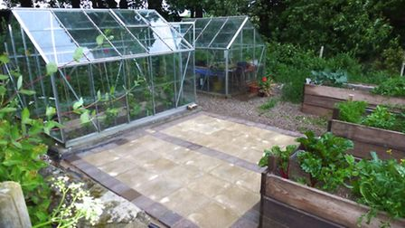 Growing space under cover is essential - the greenhouses and raised beds