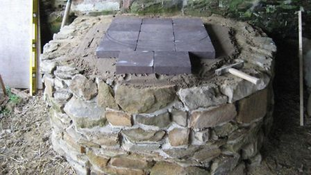 Firebricks on the plinth for the clay oven