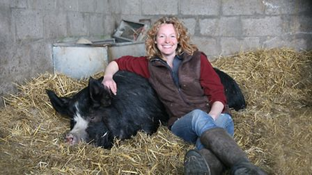 Kate cuddles a contented pig