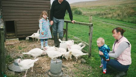 Richard and Jacqui Pilka with daughter, Sophia (4), and son Charlie (10 months) visit the poultry pe