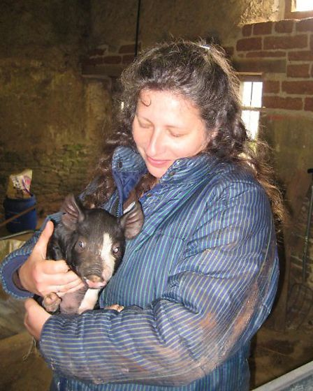 Debbie with one of her piglets