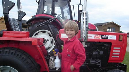 Henry Birkett, 15, son of Rabtrak owners Richard and Ivanan Birkett, with one of their compact tract