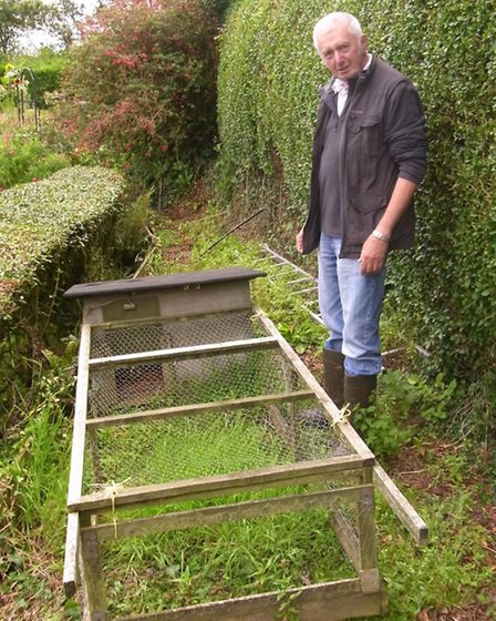 Roger Parmley with a DIY hen coop and run, based on an article from an early PSS magazine