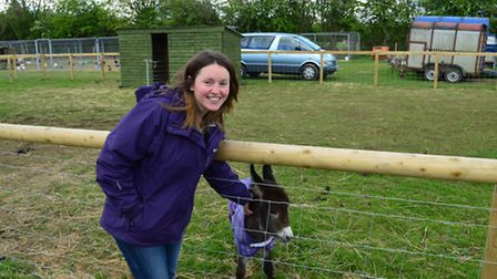 Paul's daughter Kirsten with the miniature donkey