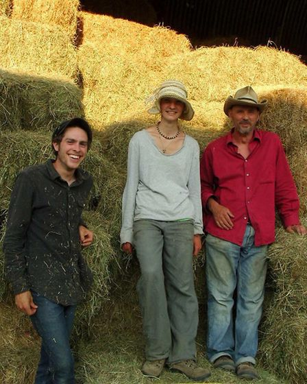 Nathan Richard, far right, after haymaking with volunteers