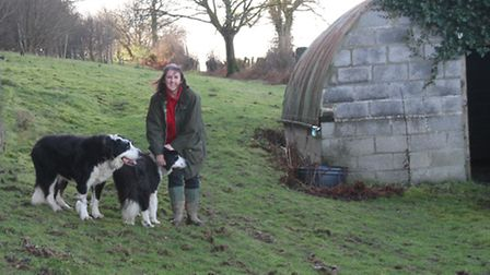 Liz beside one of her outbuildings on her new smallholding