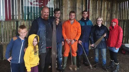 Adam and family with some of their volunteers