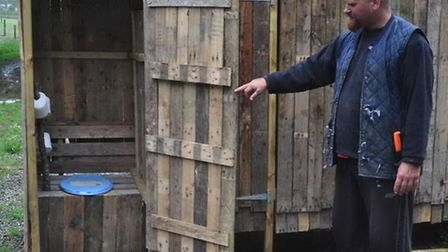 Adam and one of the compost toilets he has made