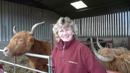 Annie Perkins in her barn with her cattle