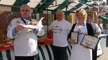 Annie being presented with prizes by chef Tom Bridge at the Evesham Pie and Ale Festival