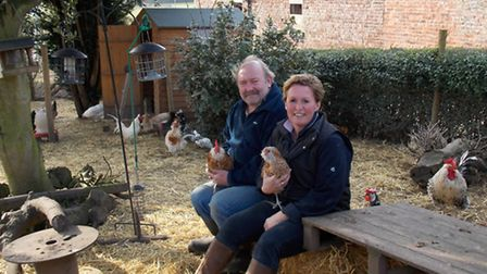 Lynda and JR with a Thuringian, one of their signature chickens