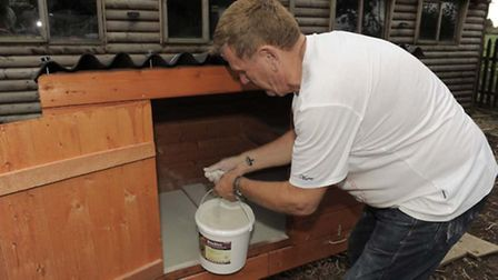 Poultry breeder Terry Beebe preparing his hen house