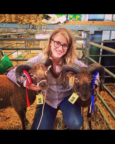 Charlotte's daughter Sophie with the sheep at a show