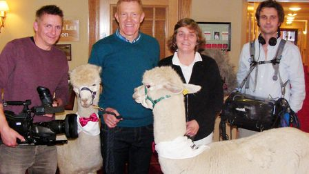 Wendy Williams and Adam Henson with a film crew and her alpacas. TWendy and her animals appeared on