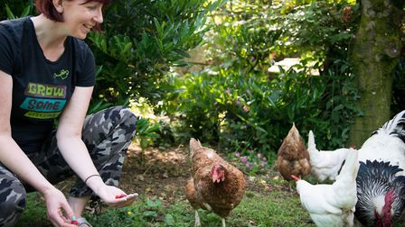 Kim with her chickens
