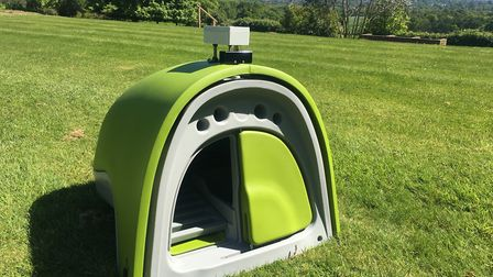 Eglu Classic coop with Hentronix automatic opener/closer on top