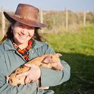 Tess with one of the 70 pigs Alderney Free Range Pigs keeps at any one time