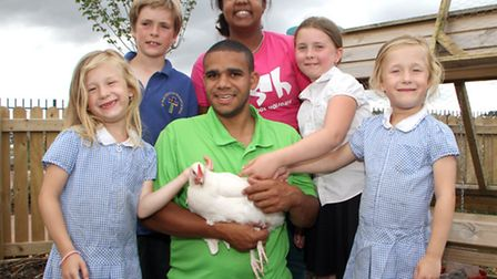 Kyle Lloyd, Ellysia Brown, Lucy Present, Mickayla Brown, Adele Brown and Dan Baxter with the chicken