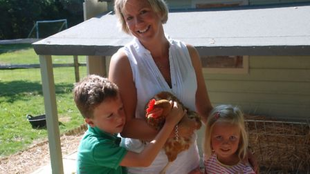 Sarah Hazebrook with her children Ted and Polly and one of their birds