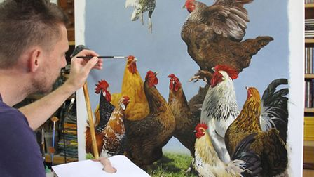 Putting the finshing touches to a painting