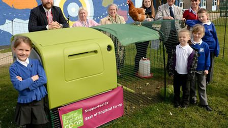 Proud pupils show off their chickens to directors from the East of England Co-op