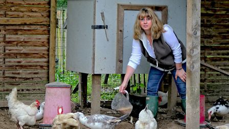 Janine Marsh feeding chickens at her home in France